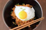 """<p>The <a href=""""https://www.popsugar.com/food/Kimchi-Fried-Rice-Recipe-22273793"""" class=""""link rapid-noclick-resp"""" rel=""""nofollow noopener"""" target=""""_blank"""" data-ylk=""""slk:Kimchi fried rice"""">Kimchi fried rice</a> is definitely not for the weak, but is for those who dare to love the strong, spicy flavor of Korea's iconic pickled veggies.</p>"""