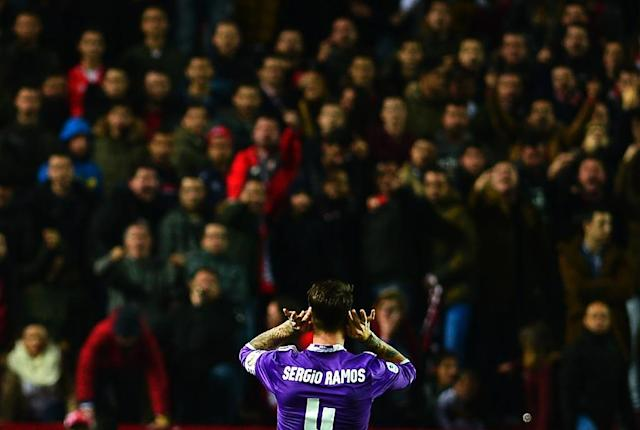 Real Madrid's defender Sergio Ramos celebrates after scoring a goal during their Spanish Copa del Rey match against Sevilla at the Ramon Sanchez Pizjuan stadium in Sevilla on January 12, 2017 (AFP Photo/CRISTINA QUICLER )