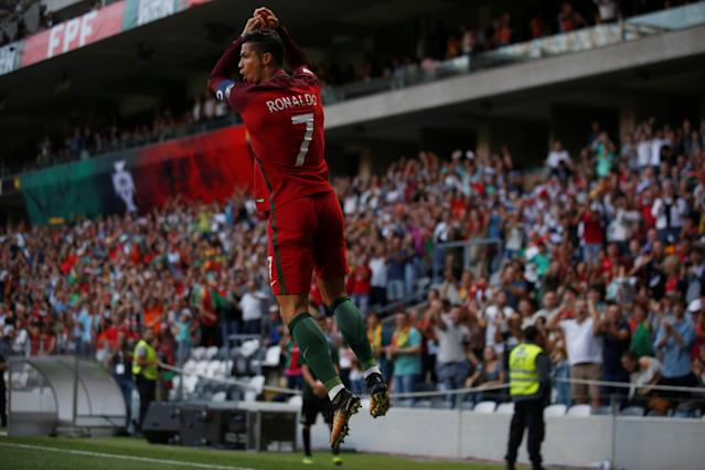 "<a class=""link rapid-noclick-resp"" href=""/soccer/players/cristiano-ronaldo/"" data-ylk=""slk:Cristiano Ronaldo"">Cristiano Ronaldo</a>'s hat trick against the Faroe Islands handed the superstar a couple milestones. (Reuters)"