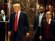 U.S. President-elect Donald Trump and Softbank CEO Masayoshi Son exit together after meeting at Trump Tower in Manhattan, New York City, U.S., December 6, 2016. REUTERS/Brendan McDermid