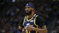 Utah Jazz guard Mike Conley (10) walls up court in the second half during an NBA basketball game against the Phoenix Suns Monday, Feb. 24, 2020, in Salt Lake City. (AP Photo/Rick Bowmer)