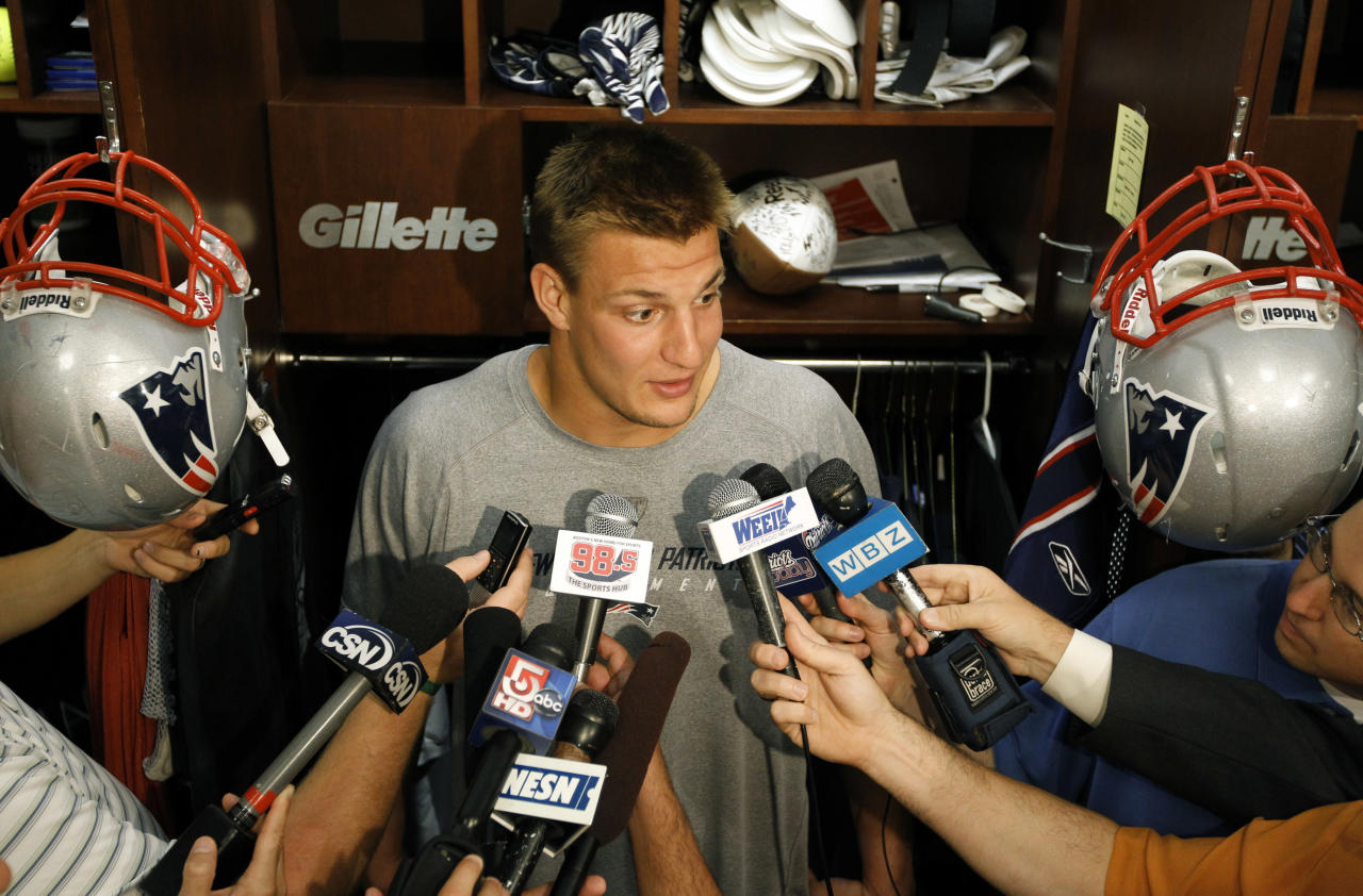 New England Patriots tight end Rob Gronkowski speaks with members of the media in the teams locker room at Gillette Stadium, in Foxborough, Mass., Monday, Sept. 26, 2011. The Patriots were defeated, 34-31, by the Buffalo Bills Sunday, Sept. 25, 201. (AP Photo/Steven Senne)