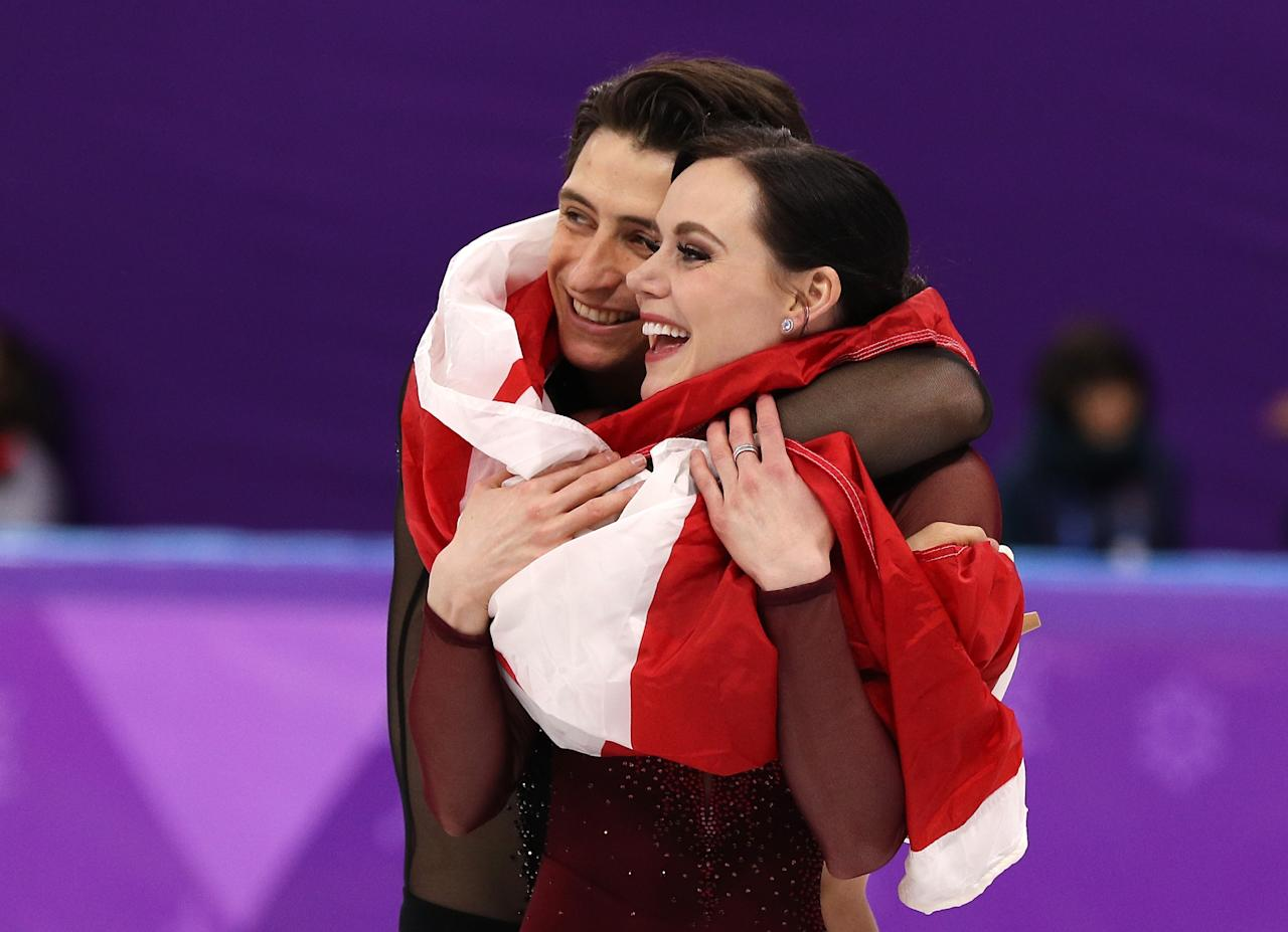 <p>Gold medal winners Tessa Virtue and Scott Moir of Canada celebrate during the victory ceremony for the Figure Skating Ice Dance Free Dance at the PyeongChang 2018 Winter Olympic Games on February 20, 2018.<br />(Photo by Maddie Meyer/Getty Images) </p>