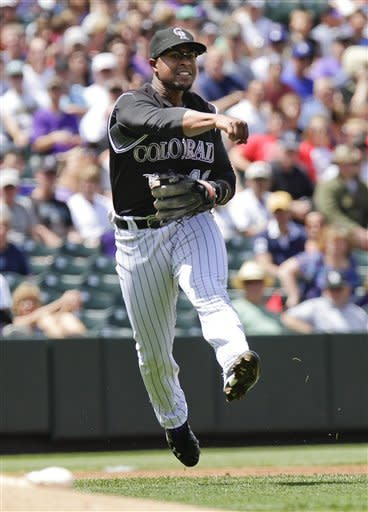 Colorado Rockies third baseman Chris Nelson (10) throws out Los Angeles Dodgers' Juan Rivera at first base during the first inning of a baseball game, Wednesday, May 2, 2012, in Denver. (AP Photo/Barry Gutierrez)