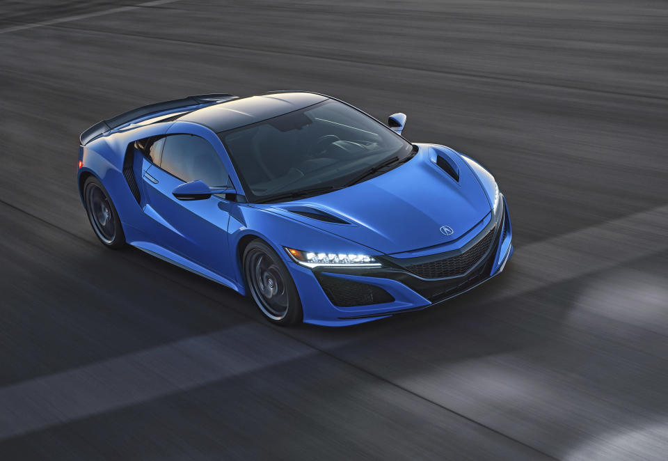 This photo provided by Acura shows the 2021 Acura NSX, an exotic sports car with a hybrid powertrain and sharp handling. (Jeff Ludes/American Honda Motor Co. via AP)