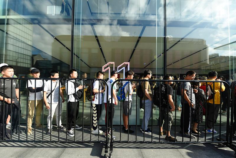 Customers queue outside an Apple store to buy the latest iPhone models in Hangzhou in China's eastern Zhejiang province on September 20, 2019. (Photo by STR / AFP) / China OUT (Photo credit should read STR/AFP/Getty Images)