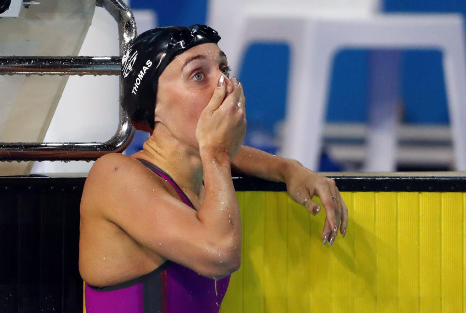 Thomas reacts to her first place result in the Commonwealth Games final (Picture: Reuters)