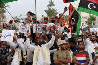 Hundreds of demonstrators protest in Tripoli, Libya, on Friday, Sept. 24, 2021, in opposition to the country's parliament passing a vote of no-confidence in the transitional government. The motion, passed on Tuesday, represents a challenge to planned December elections and impedes efforts to unite the oil-rich North African nation after a decade of turmoil. (AP Photo/Yousef Murad)