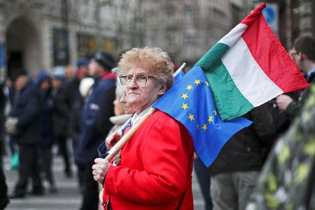 A woman protests against the government at a rally organised by opposition parties during Hungary's National Day celebrations, which also commemorates the 1848 Hungarian Revolution against the Habsburg monarchy, in Budapest, Hungary, March 15, 2019. REUTERS/Lisi Niesner