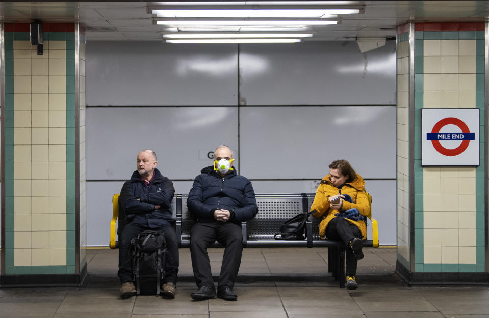 LONDON, ENGLAND - MARCH 23: Commuters wearing face protection masks travel on the Central Line on March 23, 2020 in London, United Kingdom. Coronavirus (COVID-19) pandemic has spread to at least 182 countries, claiming over 10,000 lives and infecting hundreds of thousands more. (Photo by Justin Setterfield/Getty Images)