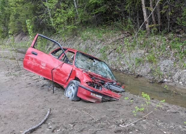 A car stuck in the mud along West Fraser Road in Quesnel after washouts and slides in 2018.
