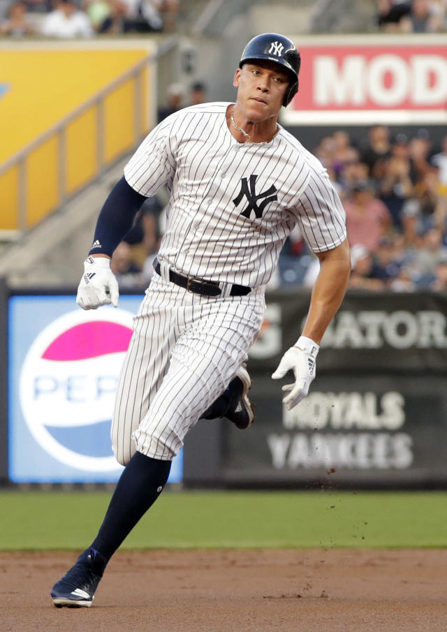 New York Yankees' Aaron Judge runs to third base on a double by Didi Gregorius during the first inning of the team's baseball game against the Kansas City Royals on Thursday, July 26, 2018, in New York. (AP Photo/Frank Franklin II)