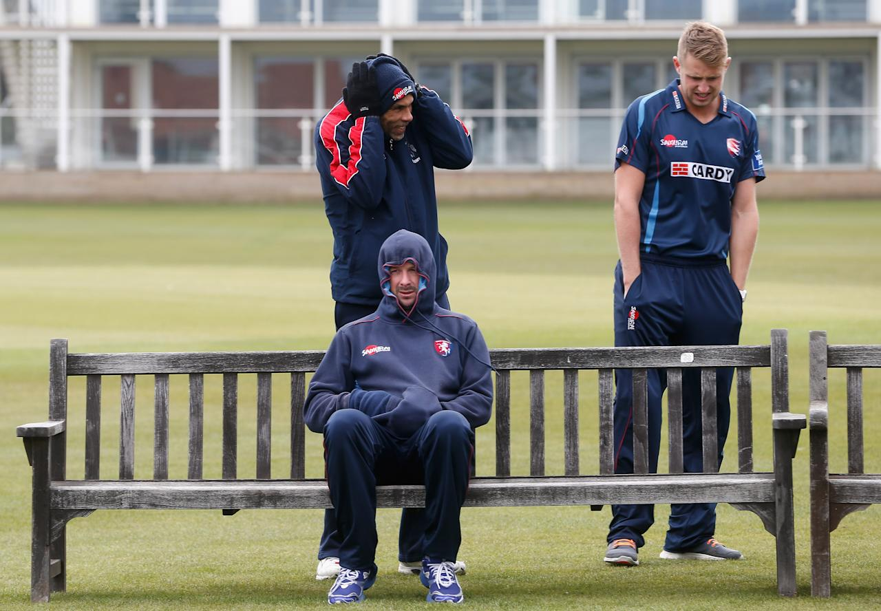 CANTERBURY, ENGLAND - MARCH 25:  Darren Stevens of Kent, Jimmy Adams the Kent coach and Alex Blake of Kent wait in the freezing cold for the team shot during the Kent County Cricket Club photocall at St Lawrence Ground on March 25, 2013 in Canterbury, England.  (Photo by Tom Shaw/Getty Images)