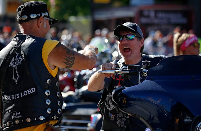 Bikers greet each other on the city's busy streets.