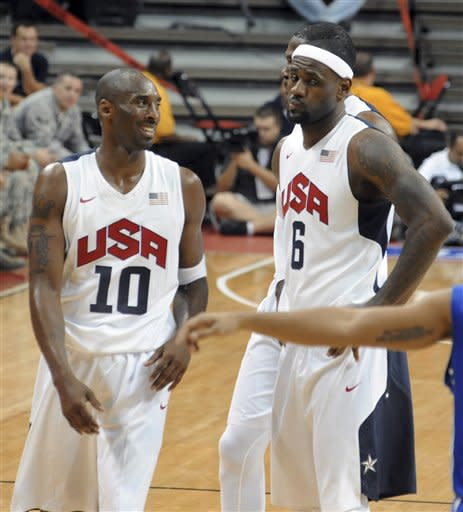 In this photo provided by the Las Vegas News Bureau, U.S. Olympic men's basketball team members Kobe Bryant and LeBron James react to a foul call during an exhibition game against the Dominican Republic in Las Vegas on Thursday, July 12, 2012. The United States won 113-59. (AP Photo/Las Vegas News Bureau, Brian Jones)