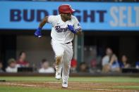Texas Rangers' Andy Ibanez sprints towards first on his two-run single in the second inning of a baseball game against the Los Angeles Angels in Arlington, Texas, Tuesday, Sept. 28, 2021. (AP Photo/Tony Gutierrez)