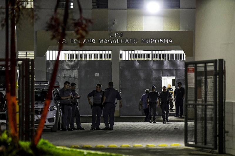Military police officers are seen at the main entrance of the Doctor Edgar Magalhaes Noronha (Pemano) Penitentiary during a riot on early March 17, 2020, in Tremembe, 155 km from Sao Paulo, Brazil. - Hundreds of prisoners rebelled and fled from various jails in the interior of Sao Paulo on March 16 after authorities suspended a temporary release of inmates to prevent the spread of the coronavirus. More than 440 were already recaptured. (Photo by Lucas LACAZ / AFP) (Photo by LUCAS LACAZ/AFP via Getty Images)