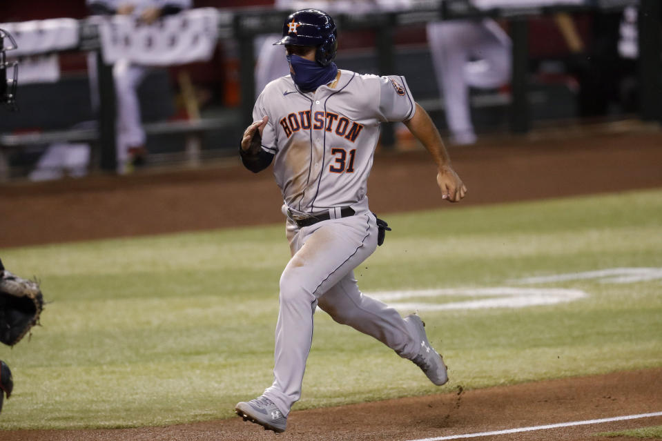 Houston Astros' Abraham Toro (31) scores on a sacrifice fly hit by teammate George Springer during the second inning of a baseball game Tuesday, Aug. 4, 2020, in Phoenix. (AP Photo/Matt York)