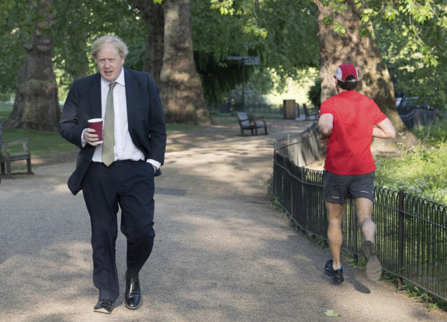 Boris Johnson, pictured walking through London's St James's Park on Wednesday, told leaders of the devolved nations that their lockdowns could be lifted at 'different speeds'. (Stefan Rousseau/PA via AP)