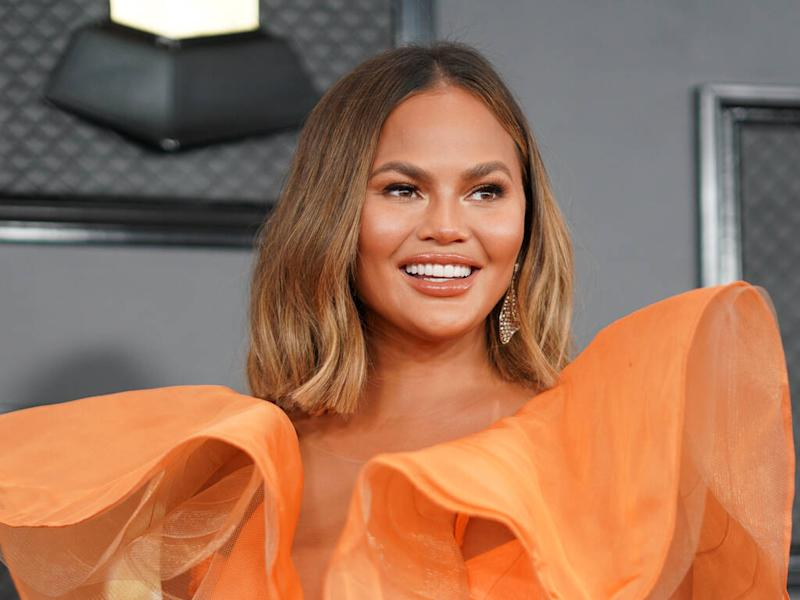 Chrissy Teigen wants to get breast implants removed