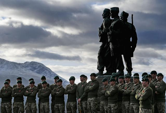 <p>Serving servicemen and veterans gather at Commando Memorial, Spean Bridge where they observed a two minute silence as a mark of respect for the war dead on Nov. 11, 2017 in Spean Bridge, Scotland. (Photo: Jeff J Mitchell/Getty Images) </p>
