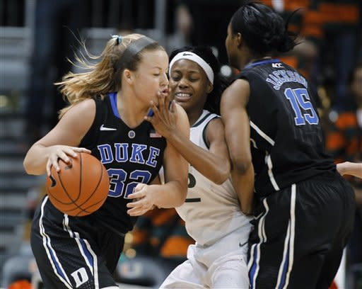 Duke's Tricia Liston, left, moves the ball on Miami's Krystal Saunders, center, as Duke's Richa Jackson (15) sets a pick during the first half of an NCAA college basketball game in Coral Gables, Fla., Thursday, Feb. 28, 2013. (AP Photo/Luis M. Alvarez)