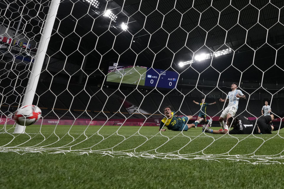 Australia's Lachlan Wales scores his side's opening goal against Argentina during a men's soccer match at the 2020 Summer Olympics, Thursday, July 22, 2021, in Sapporo, Japan. (AP Photo/SIlvia Izquierdo)