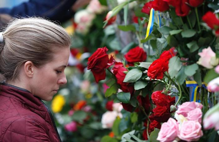 Flowers have been piling up at the scene of the attack (AFP Photo/Odd ANDERSEN)