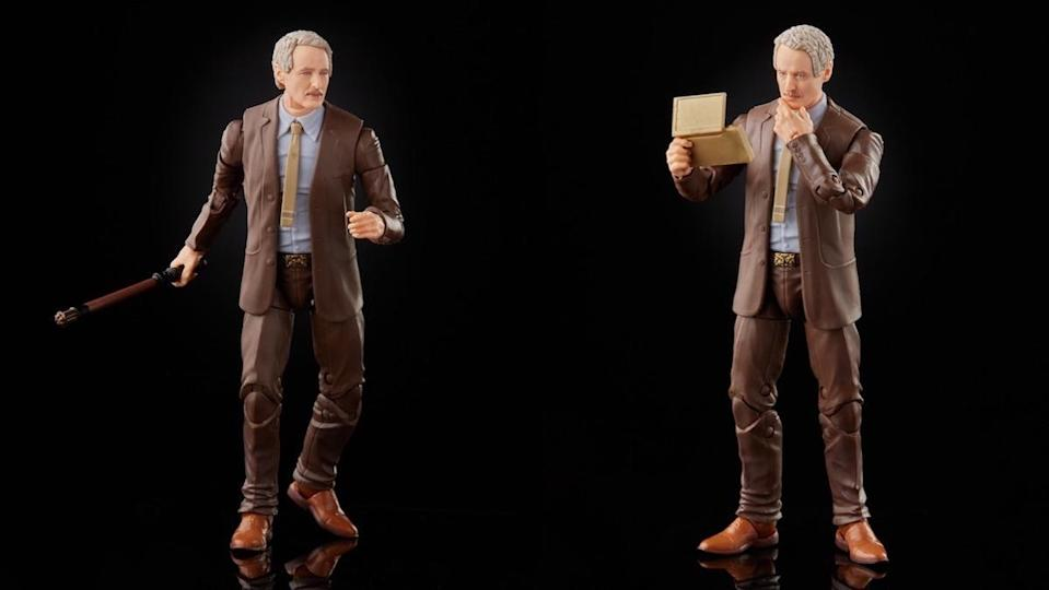 Two different poses for Owen Wilson's Loki Mobius figure, one holding a stick, the other a tablet he's looking at