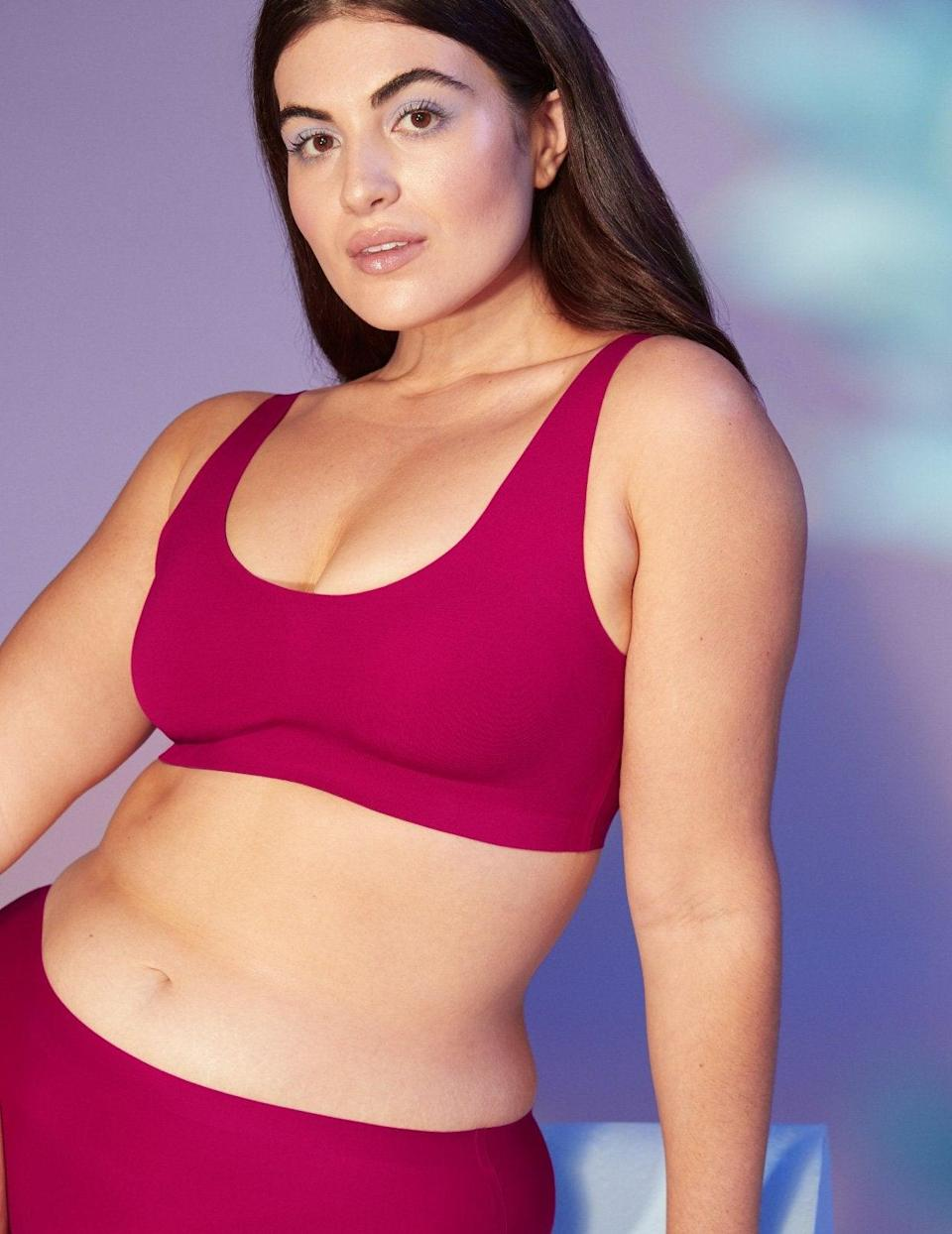 """<h2>Knix LuxeLift Pullover Bra</h2><br><strong>Size range: </strong>XXS - XXXL+<br>This completely hardware-free pullover style is way more supportive than its super-smooth appearance lets on — it offers a comfortable lift for boobs up to size 44G.<br><br><br><strong>Knix</strong> LuxeLift Pullover Bra, $, available at <a href=""""https://go.skimresources.com/?id=30283X879131&url=https%3A%2F%2Fknix.com%2Fcollections%2Fbras%2Fproducts%2Fluxelift-pullover-bra-cerise"""" rel=""""nofollow noopener"""" target=""""_blank"""" data-ylk=""""slk:Knix"""" class=""""link rapid-noclick-resp"""">Knix</a>"""