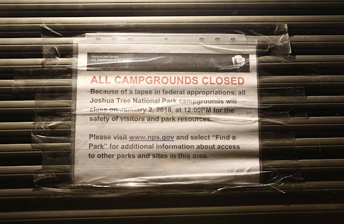An 'All Campgrounds Closed' sign is posted at shuttered entrance station at Joshua Tree National Park on Jan. 3, 2019 in Joshua Tree, California. The gate is normally staffed during the day but is now unstaffed 24 hours per day, allowing free entrance for all visitors. Campgrounds have been closed at the park and other services suspended during the partial government shutdown. (Photo: Mario Tama/Getty Images)