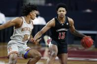 Boston College's Demarr Langford Jr. (15) defends against Louisville's David Johnson (13) during the first half of an NCAA college basketball game, Saturday, Jan. 2, 2021, in Boston. (AP Photo/Michael Dwyer)