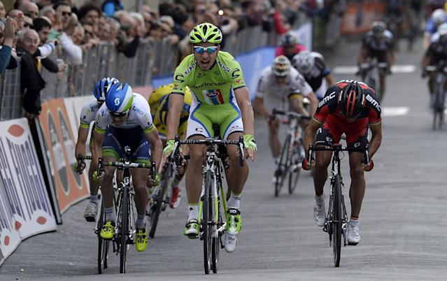 Slovakia's Peter Sagan, center, crosses the finish line to win the third stage of the Tirreno Adriatico cycling race from Cascina to Arezzo Italy, Friday, March 14, 2014. Peter Sagan showed off his uphill sprinting skills to win the third stage of the weeklong Tirreno-Adriatico race Friday, and Michal Kwiatkowski took the overall lead. Sagan, a Slovak who rides for the Cannondale team, won in 5 hours, 10 minutes, 17 seconds on the 212-kilometer (132-mile) leg from Cascina to the Tuscan town of Arezzo. (AP Photo/Fabio Ferrari, Lapresse)