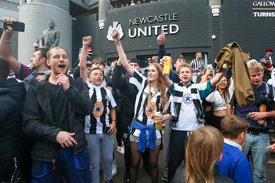 Newcastle United fans celebrate the sale of the club to the Consortium of Amanda Stavely, Jamie Rueben and PIF  Scenes at St. James's Park, Newcastle as news of a takeover emerges on Thursday 7th October 2021.  (Photo by Michael Driver/MI News/NurPhoto via Getty Images)