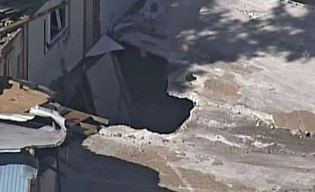 This image shows an aerial photo of the sinkhole which opened up underneath a bedroom late Thursday evening and swallowed Jeffrey Bush in Seffner, Florida. Credit: AP Photo/ABC Action News-WFTS TV)