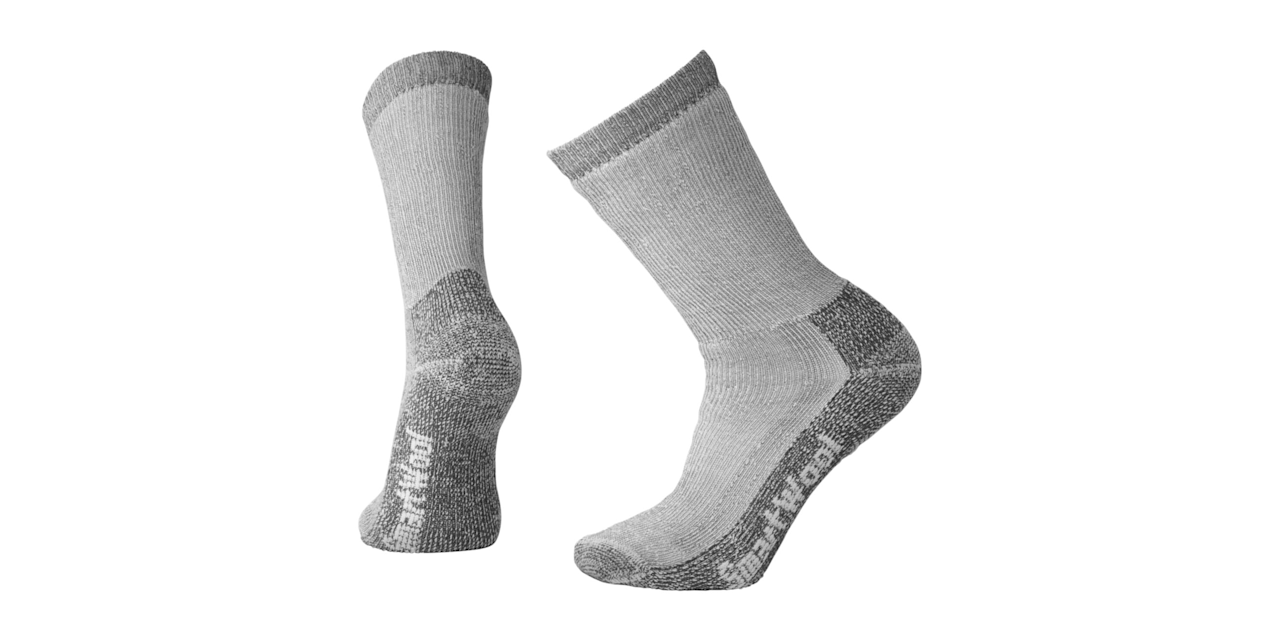 "<p><strong>SmartWool</strong></p><p>smartwool.com</p><p><strong>Out of Stock</strong></p><p><a rel=""nofollow"" href=""http://www.smartwool.com/shop/men-socks-hike/trekking-heavy-crew-socks-sw0sw131"">BUY NOW</a></p><p>On particularly cold days, I reach for my thickest socks. Pulling these guys on is like having a warmed towel waiting for you as you exit the shower. If I come in from skiing and my feet are ice cube status, I grab these guys. They're great for moving around as well though, If I pull them up high and tie my shoes tight, I can avoid the dreaded thick sock bunch up underfoot. I stay warm, they protect my shin from boot tongues, and I never have to pull my boots off to straighten out my socks, which will give you cold feet.</p>"