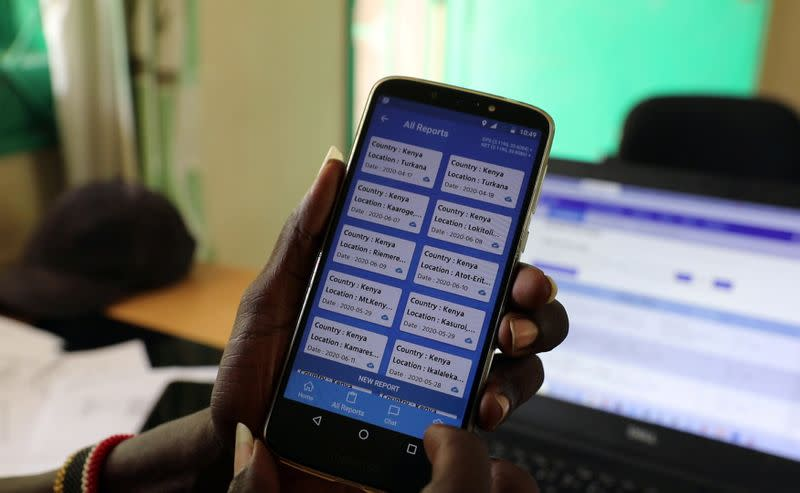 Turkana sub county crops officer Alfons Aurun displays the E-locust phone app at his office in the town of Lodwar, Turkana county