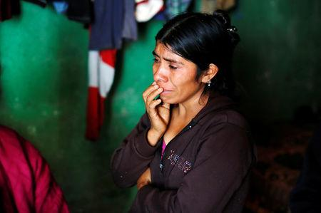 FILE PHOTO: Catarina Alonzo, mother of Felipe Gomez Alonzo, a 8-year-old boy detained alongside his father for illegally entering the U.S., who fell ill and died in the custody of U.S. Customs and Border Protection (CBP), reacts at her home in the village of Yalambojoch, Guatemala December 27, 2018. REUTERS/Luis Echeverria