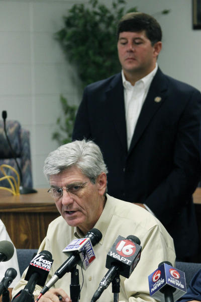 U.S. Rep. Steven Palazzo, R-Miss., rear, listens as Gov. Phil Bryant discusses Gulf Coast preparations for Tropical Storm Isaac during a news conference at the Harrison County Emergency Operations Center in Gulfport, Miss., Monday, Aug. 27, 2012. Palazzo is a Biloxi resident. (AP Photo/Rogelio V. Solis)