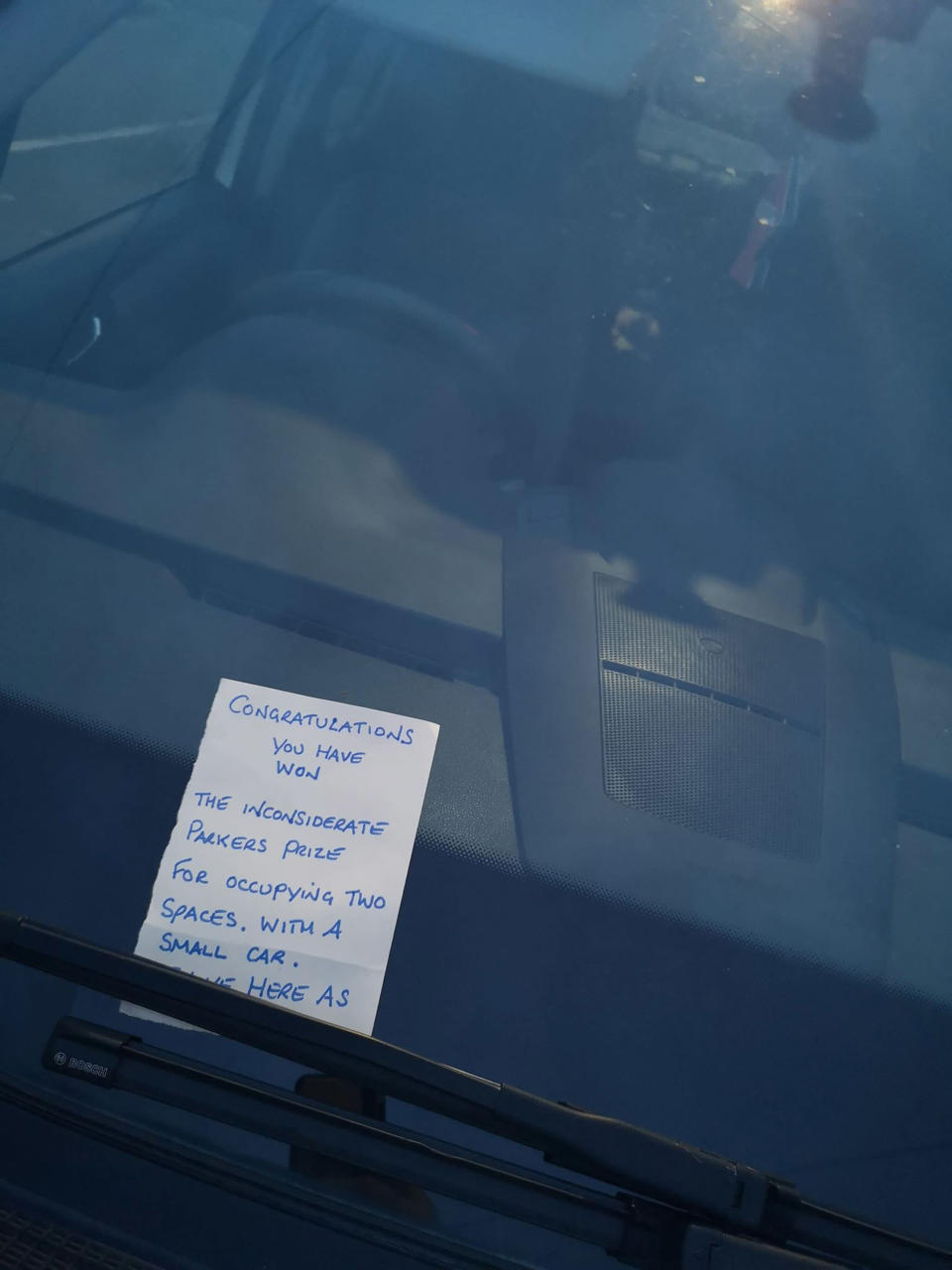 A neighbour left a passive-aggressive note on her car windscreen [Photo: Caters[