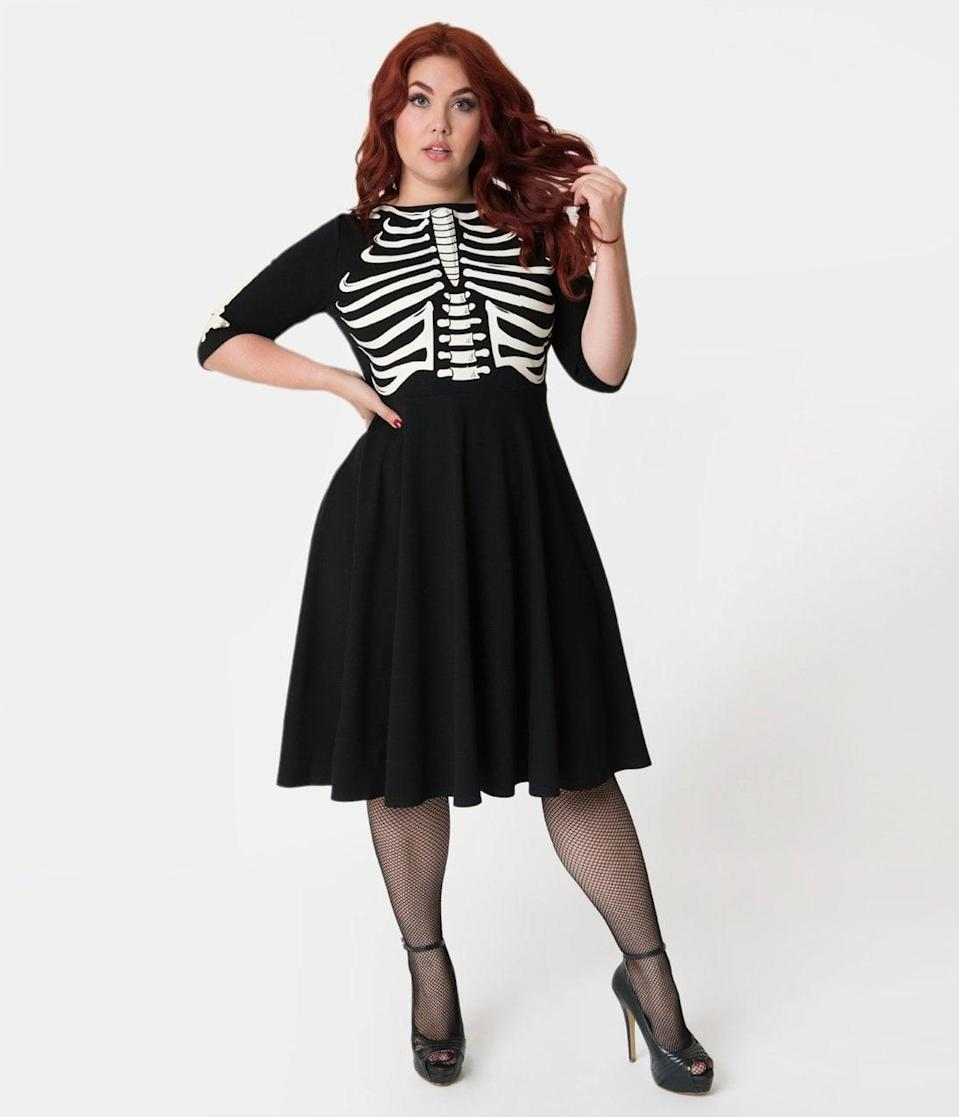 <p>Everyone will get a fright when they see how cute this <span>Unique Vintage Plus Size Black Skeleton Bones Graves Swing Dress</span> ($98) looks.</p>