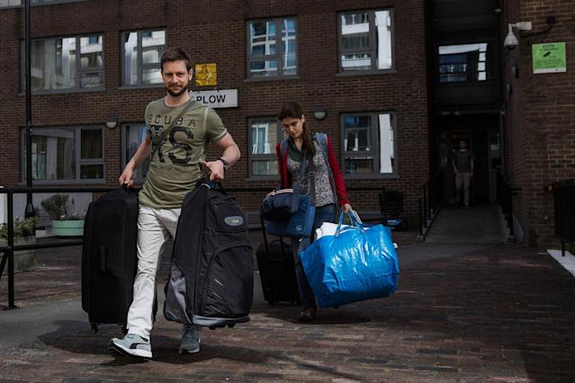 <p>Residents leave their home on the Taplow Block on the Chalcots Estate on June 26, 2017 in London, England. Residents of the Chalcots Estate have been urged to leave their homes due to fire safety fears in the wake of the Grenfell Tower tragedy. Four of the five Chalcots Estate towers in Camden, North London, are being evacuated after they were found to have similar cladding to that on Grenfell, attributed to contributing to the rapid spread of the blaze last week that killed at least 79 people (Photo: Dan Kitwood/Getty Images) </p>