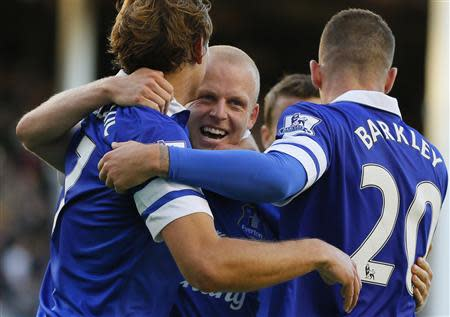 Everton's Naismith celebrates with team mates after scoring a goal against Chelsea during their English Premier League soccer match at Goodison Park in Liverpool, northern England