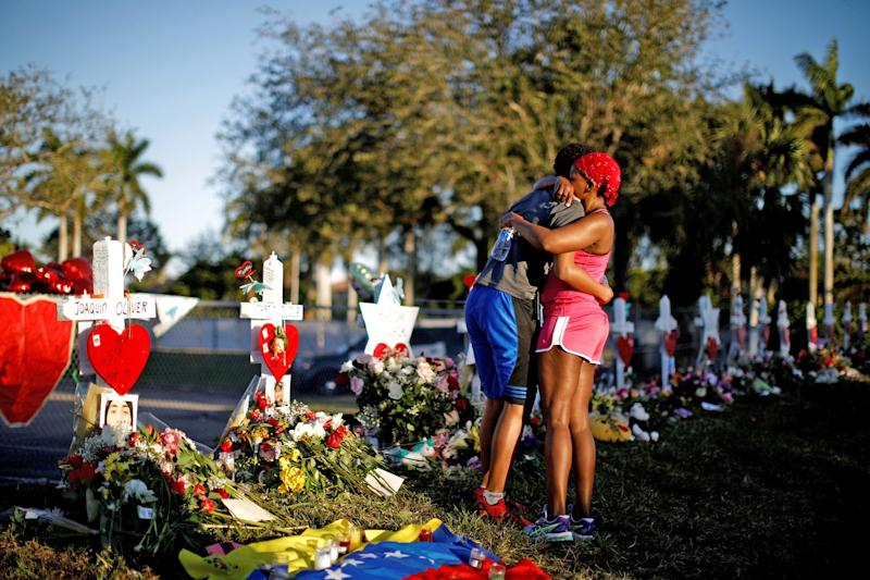 Mourners at a vigil in Parkland, Florida following the February shooting: Reuters