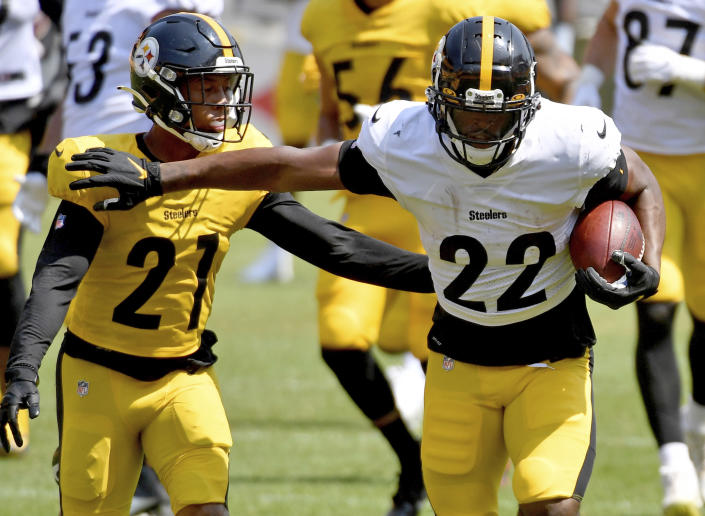 Pittsburgh Steelers running back Najee Harris carries the ball next to safety Tre Norwood during an NFL football training camp Saturday, July 31, 2021, at Heinz Field in Pittsburgh. (Matt Freed/Pittsburgh Post-Gazette via AP)