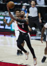 Portland Trail Blazers guard Damian Lillard (0) shoots against the Cleveland Cavaliers during the second half of an NBA basketball game in Portland, Ore., Friday, Feb. 12, 2021. (AP Photo/Craig Mitchelldyer)