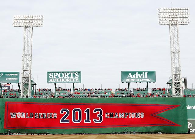 BOSTON, MA - APRIL 04: The 2013 World Series Champions Boston Red Sox banner is draped across the Green Monster prior to the Opening Day game between the Boston Red Sox and the Milwaukee Brewers at Fenway Park on April 4, 2014 in Boston, Massachusetts. (Photo by Jared Wickerham/Getty Images)