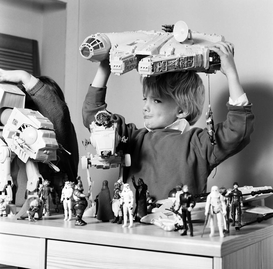 Two boys, Thomas (dark hair) and Robbin playing with their Star Wars toys. 16th November 1983. (Photo by Arthur Sidey/Mirrorpix/Getty Images)