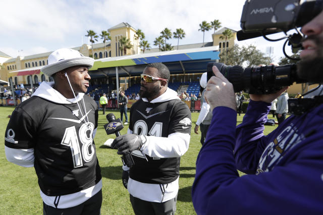 AFC running back Mark Ingram, right, of the Baltimore Ravens interviews Matthew Slater (18) of the New England Patriots after a practice for the NFL Pro Bowl football game Wednesday, Jan. 22, 2020, in Kissimmee, Fla. (AP Photo/John Raoux)