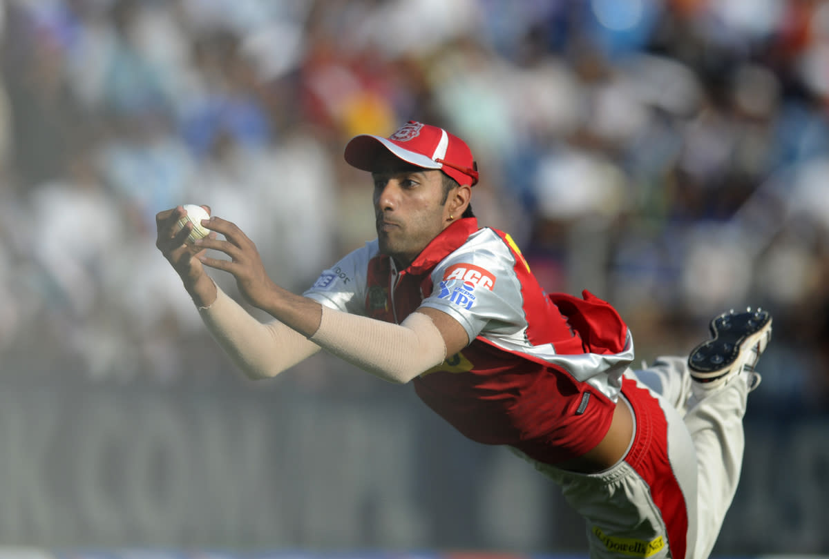 Gurkeerat Mann Singh of Kings XI Punjab dives to take a catch to get Ross Taylor of Pune Warriors out during match 6 of the the Pepsi Indian Premier League ( IPL) 2013  between The Pune Warriors India and the Kings XI Punjab held at the Subrata Roy Sahara Stadium, Pune on the 7th April  2013..Photo by Pal Pillai-IPL-SPORTZPICS ..Use of this image is subject to the terms and conditions as outlined by the BCCI. These terms can be found by following this link:..https://ec.yimg.com/ec?url=http%3a%2f%2fwww.sportzpics.co.za%2fimage%2fI0000SoRagM2cIEc&t=1498251533&sig=ueXeMy_G.XJdyaJeOZxtbg--~C